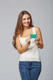 Happy smiling girl in casual clothing, showing blank credit card Stock Images
