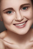Happy smiling girl with clean skin, healthy white teeth Royalty Free Stock Photography