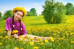 Happy smiling girl with dandelions Royalty Free Stock Photos