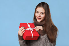 Happy smiling girl in excitement with Christmas box. Christmas Gift Royalty Free Stock Image