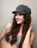 Happy smiling girl in fashion cap Stock Photography