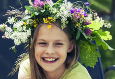 Happy smiling girl with flower wreath Stock Photography