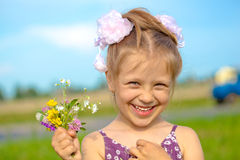 Happy smiling girl with flowers. Having fun outdoor Royalty Free Stock Image