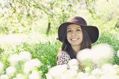 Happy smiling girl in a garden Stock Photography