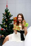 Happy smiling girl with gift Stock Images