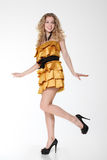 Happy smiling girl in golden dress Stock Photography
