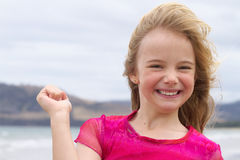 Happy smiling girl with hand raised Stock Photography