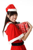 Happy smiling girl holding christmas gift Royalty Free Stock Photo