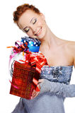 Happy smiling girl holding christmas  presents Royalty Free Stock Images