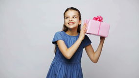 Happy smiling girl holding gift box stock footage