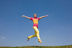 Happy smiling girl - jumping Stock Photography