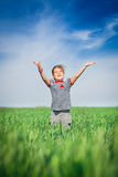 Happy smiling girl jumping at the field of wheat Stock Images