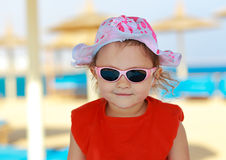 Happy smiling girl kid on. The beach. Closeup portrait Royalty Free Stock Photos