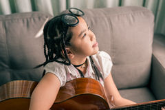 Happy smiling girl ,learning to play the acoustic guitar Royalty Free Stock Photos