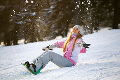 Happy smiling girl with lifted hands  on snowboard Stock Photography