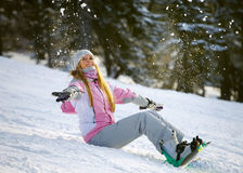 Happy smiling girl with lifted hands  on snowboard Stock Photo