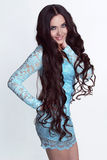 Happy smiling girl model. Healthy Long Curly Hair Royalty Free Stock Image