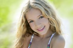 Happy smiling girl portrait green outdoor Stock Photography