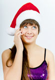 Happy smiling girl with Santa hat with a phone Royalty Free Stock Photo