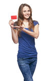Happy smiling girl showing blank credit card Stock Photos