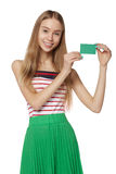 Happy smiling girl showing blank credit card, on white backgroun Stock Image