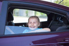 Happy smiling girl sitting inside of car Stock Photo