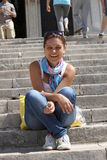 Happy smiling girl sitting on the steps Stock Photo