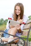 Happy smiling girl and tablet computer Stock Photography