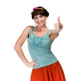 Happy smiling girl with thumbs up gesture Stock Images