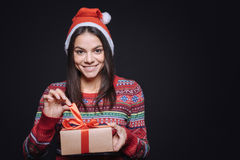 Happy smiling girl unpacking the box with a gift Royalty Free Stock Image