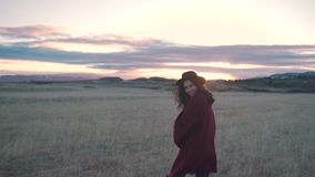 Happy smiling girl walks in the field stock footage