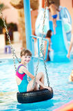 Smiling child in resort swimming pool Royalty Free Stock Photography
