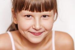 Happy smiling girl wearing bangs Stock Images