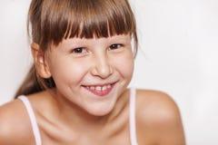 Happy smiling girl wearing bangs Stock Photo