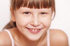 Happy smiling girl wearing bangs Royalty Free Stock Photography