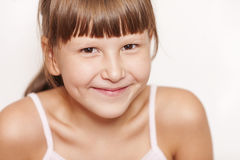 Happy smiling girl wearing bangs Royalty Free Stock Photo