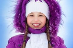 Happy smiling girl in winter clothes Stock Photography