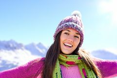 Happy smiling girl in winter mountains. Royalty Free Stock Images
