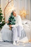 Happy smiling girl woman in Christmas atmosphere. Christmas holiday. Royalty Free Stock Images