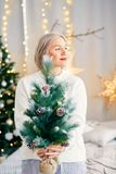 Happy smiling girl woman in Christmas atmosphere. Christmas holiday. Stock Image