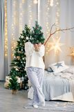 Happy smiling girl woman in Christmas atmosphere. Christmas holiday. Royalty Free Stock Image