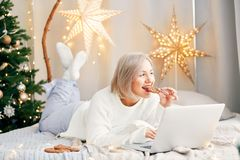 Happy smiling girl woman in Christmas atmosphere. Christmas holiday. Stock Photos