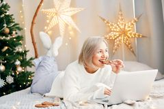 Happy smiling girl woman in Christmas atmosphere. Christmas holiday. Stock Images