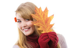 Happy smiling girl in woolen gloves holding autumnal leaf Stock Photo