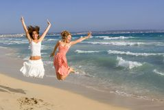 Happy smiling girls jumping royalty free stock photos