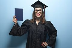 Happy smiling graduate female student with diploma stock images