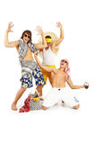 Happy smiling group in beach clothes. Picture of attractive young celebrating guys. Isolated over white Royalty Free Stock Photo
