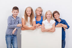 Happy smiling group of kids, boys and girls royalty free stock image