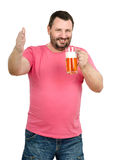 Jolly bartender toasting with light beer mug. Jolly mature bearded bartender in red t-shirt toasting with light beer and looking at camera on white background Stock Photo