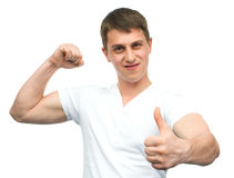 Happy smiling guy showing thumb up hand sign Royalty Free Stock Image